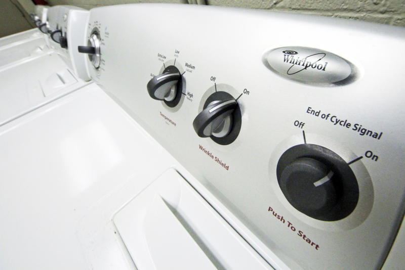 FILE- This Jan. 19, 2012, file photo shows whirlpool dryers in an apartment building laundry in Pittsburgh. The Whirlpool Corporation reports financial results Monday, Jan. 28, 2019. (AP Photo/Gene J. Puskar, File)