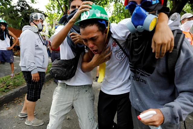 <p>Demonstrator affected by tear gas reacts while rallying against Venezuela's President Nicolas Maduro in Caracas, Venezuela May 1, 2017. (Photo: Carlos Garcia Rawlins/Reuters) </p>
