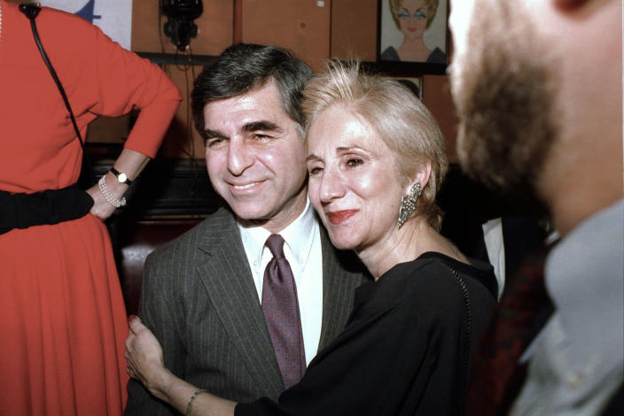 """FILE - In this Feb. 23, 1988 file photo, Massachusetts Gov. Michael Dukakis poses with cousin Olympia Dukakis during fundraiser in New York. Olympia Dukakis, the veteran stage and screen actress whose flair for maternal roles helped her win an Oscar as Cher's mother in the romantic comedy """"Moonstruck,"""" has died. She was 89. (AP Photo/Ray Stubblebine, File)"""