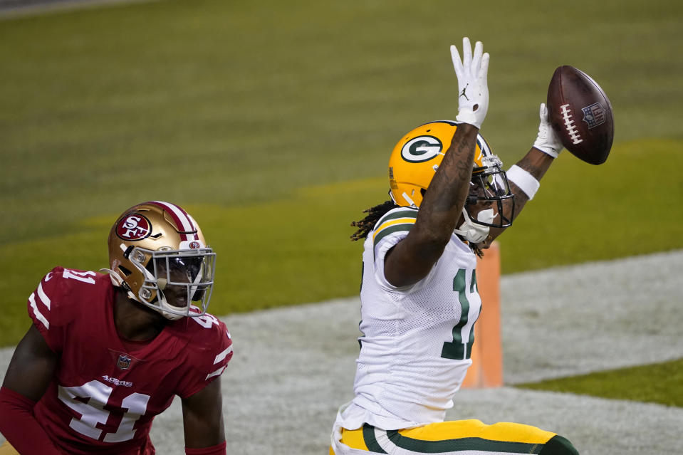 Green Bay Packers wide receiver Davante Adams, right, celebrates after catching a touchdown pass next to San Francisco 49ers cornerback Emmanuel Moseley (41) during the first half of an NFL football game in Santa Clara, Calif., Thursday, Nov. 5, 2020. (AP Photo/Tony Avelar)