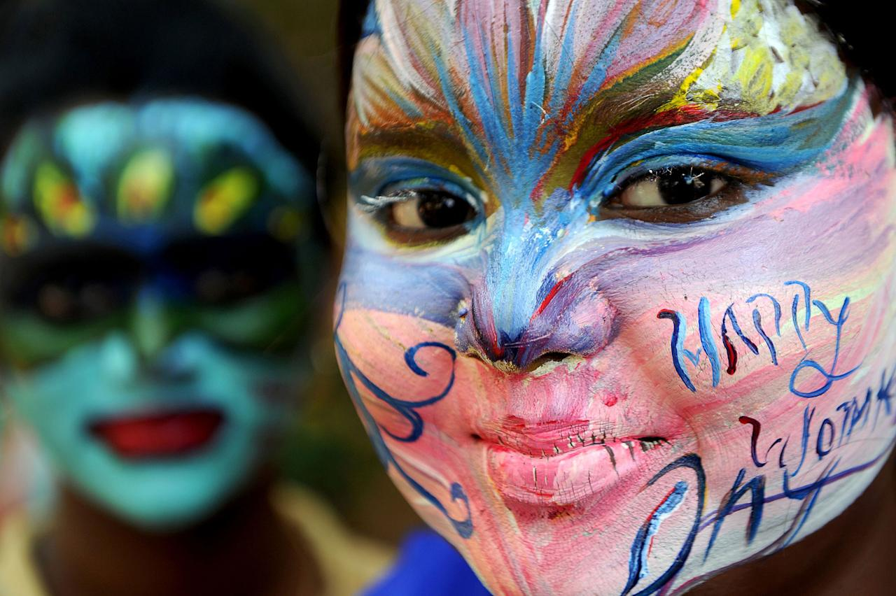 <p>Indian students pose with their faces painted at a college in Chennai, India on March 7, 2017, ahead of International Women's Day. (Arun Sankar/AFP/Getty Images) </p>