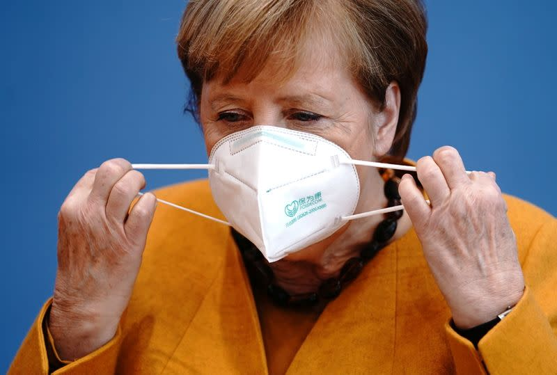 German Chancellor Angela Merkel holds a news conference in Berlin