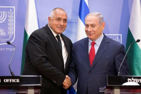 Israeli Prime Minister Benjamin Netanyahu shakes hands with Bulgarian Prime Minister Boyko Borissov during a meeting at the prime minister's office in Jerusalem, June 13, 2018. Abir Sultan/Pool via Reuters