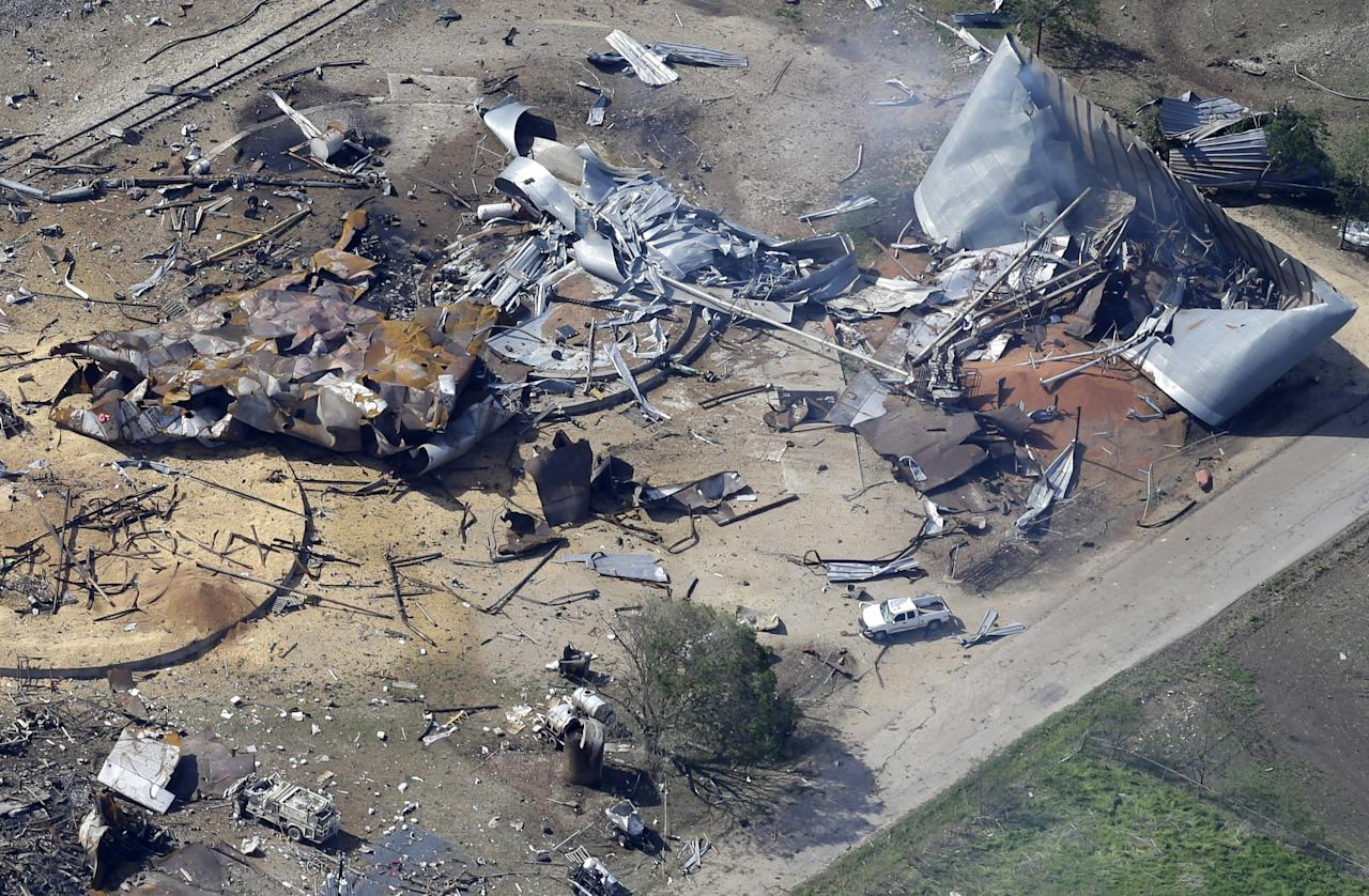 <p> This aerial photo shows the remains of a fertilizer plant destroyed by an explosion and an emergency responders vehicle, bottom left, in West, Texas, Thursday, April 18, 2013. Rescuers searched the smoking remnants for survivors of Wednesday night's thunderous fertilizer plant explosion, gingerly checking smashed houses and apartments for anyone still trapped in debris while the community awaited word on the number of dead. (AP Photo/Tony Gutierrez)