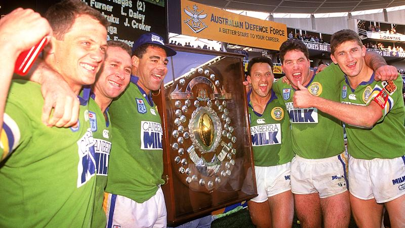Steve Walters, Ricky Stuart, Mal Meninga, Laurie Daley, Bradley Clyde and Brett Mullins of the Raiders celebrate after winning the 1994 ARL Grand Final between the Canberra Raiders and the Canterbury Bulldogs. The Raiders won 36-12. (Photo by Getty Images)