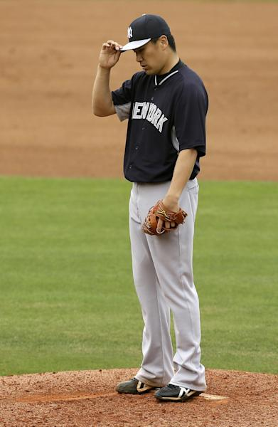 New York Yankees starting pitcher Masahiro Tanaka reacts after giving up a home run to Philadelphia Phillies' Freddy Galvis during the third inning of an exhibition baseball game Thursday, March 6, 2014, in Clearwater, Fla. (AP Photo/Charlie Neibergall)