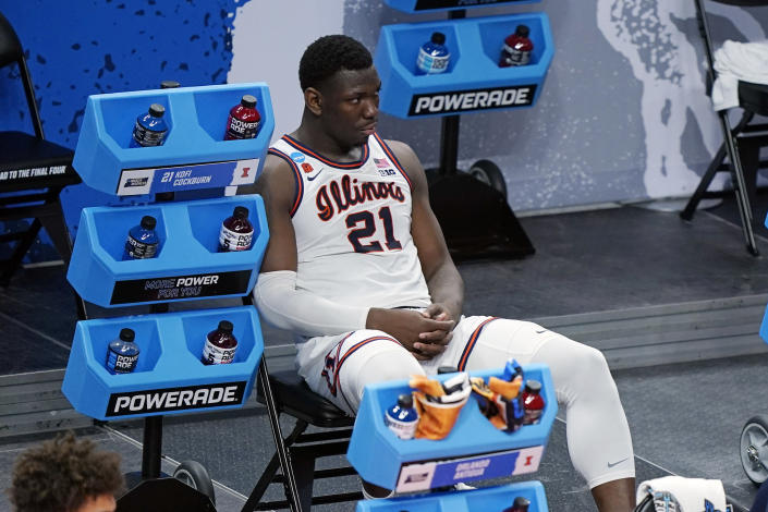 Illinois' Kofi Cockburn watches the final moments of Illinois' loss to Loyola of Chicago in a college basketball game in the second round of the NCAA tournament at Bankers Life Fieldhouse in Indianapolis Sunday, March 21, 2021. Loyola upset Illinois 71-58. (AP Photo/Mark Humphrey)