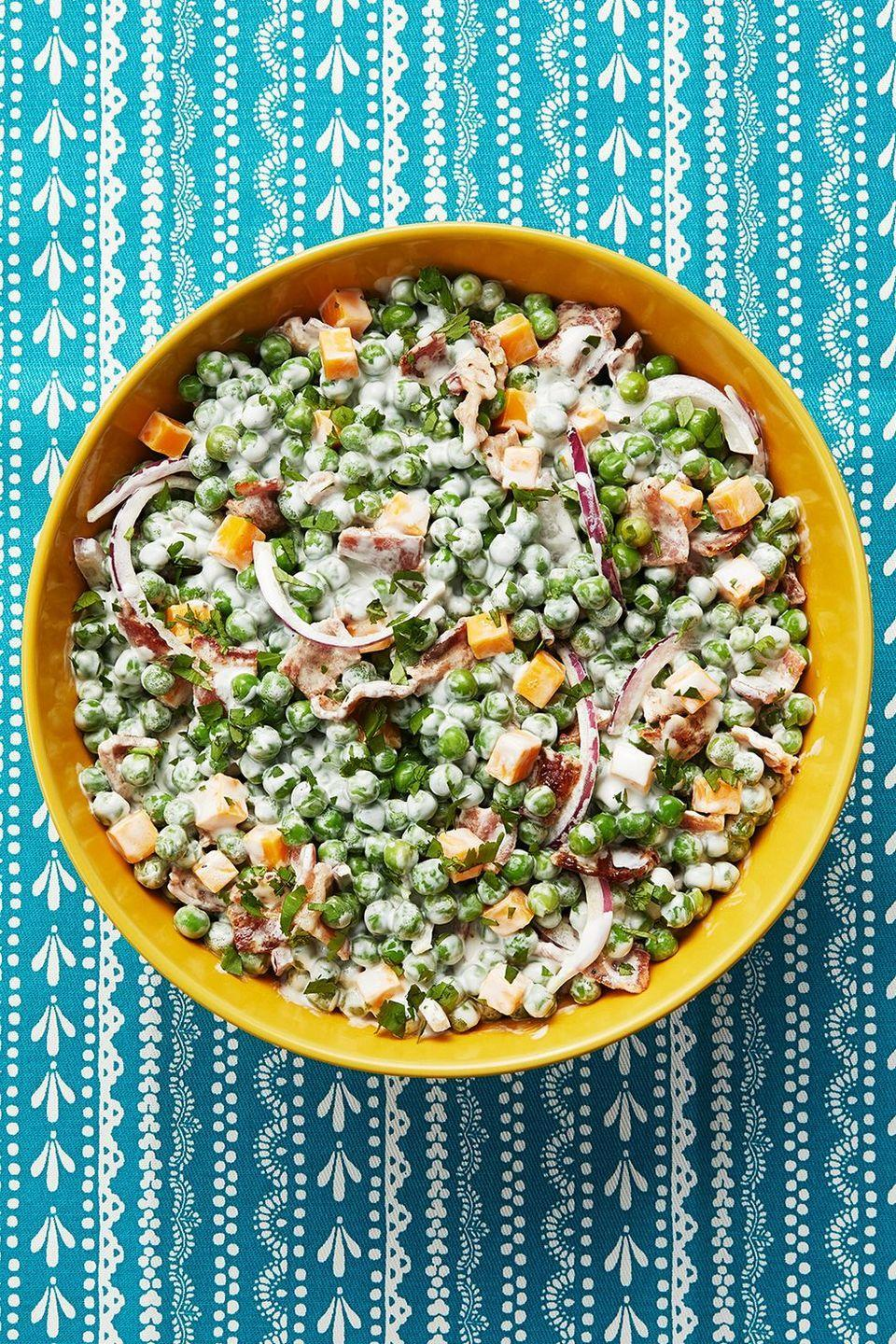 """<p>This recipe is a favorite from Ree's childhood! It's a hearty salad, made with peas, bacon, and cheddar cheese.</p><p><strong><a href=""""https://www.thepioneerwoman.com/food-cooking/recipes/a12025/pea-salad/"""" rel=""""nofollow noopener"""" target=""""_blank"""" data-ylk=""""slk:Get the recipe."""" class=""""link rapid-noclick-resp"""">Get the recipe.</a></strong></p><p><strong><a class=""""link rapid-noclick-resp"""" href=""""https://go.redirectingat.com?id=74968X1596630&url=https%3A%2F%2Fwww.walmart.com%2Fsearch%2F%3Fquery%3Dpioneer%2Bwoman%2Bserving%2Bbowls&sref=https%3A%2F%2Fwww.thepioneerwoman.com%2Ffood-cooking%2Fmeals-menus%2Fg35585877%2Feaster-recipes%2F"""" rel=""""nofollow noopener"""" target=""""_blank"""" data-ylk=""""slk:SHOP SERVING BOWLS"""">SHOP SERVING BOWLS</a></strong></p>"""