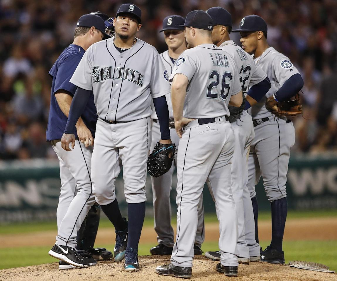 Seattle Mariners' Felix Hernandez leaves a baseball game against the Chicago White Sox during the eighth inning, Friday, Aug. 26, 2016, in Chicago. (AP Photo/Kamil Krzaczynski)