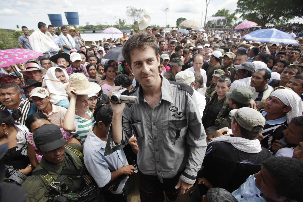 French journalist Romeo Langlois holds a video camera after arriving, escorted by rebels of the Revolutionary Armed Forces of Colombia (FARC), to San Isidro in southern Colombia, Wednesday, May 30, 2012. Langlois, who was taken by rebels on April 28 when they attacked troops he was accompanying on a cocaine-lab eradication mission, was handed over by the rebels to a delegation that included a French diplomat in San Isidro. (AP Photo/Fernando Vergara)