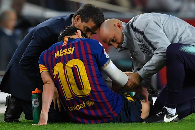 The sight of Lionel Messi on the ground during Barca's win over Sevilla prompted reactions inside Camp Nou normally reserved for the conceding of goals (AFP Photo/LLUIS GENE)