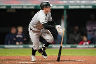 Chicago White Sox's Andrew Vaughn hits a two-run single in the sixth inning in the second baseball game of a doubleheader against the Cleveland Indians, Thursday, Sept. 23, 2021, in Cleveland. (AP Photo/Tony Dejak)