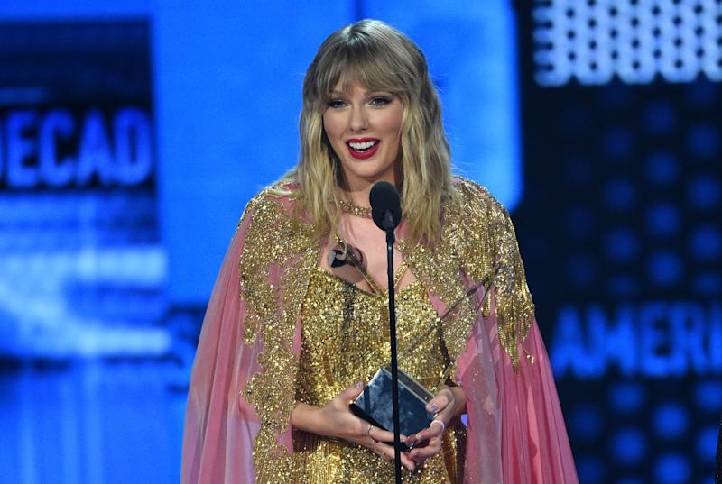 Taylor Swift accepts the award for artist of the decade at the American Music Awards on Sunday, Nov. 24, 2019, at the Microsoft Theater in Los Angeles. (Photo: Chris Pizzello/Invision/AP)