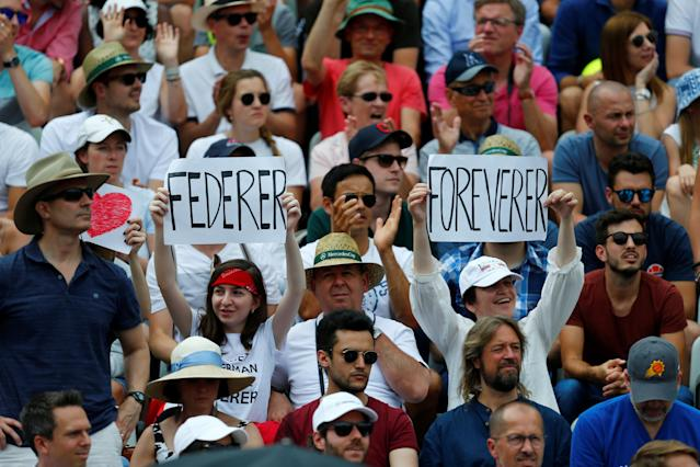 Tennis - ATP 250 - Stuttgart Open - Tennis Club Weissenhof, Stuttgart, Germany - June 17, 2018 Fans display banners referencing Roger Federer during the final between Switzerland's Roger Federer and Canada's Milos Raonic REUTERS/Ralph Orlowski