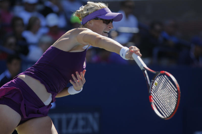 Mirjana Lucic-Baroni serves to Simona Halep during their US Open women's singles match in New York on August 29, 2014 (AFP Photo/Kena Betancur)
