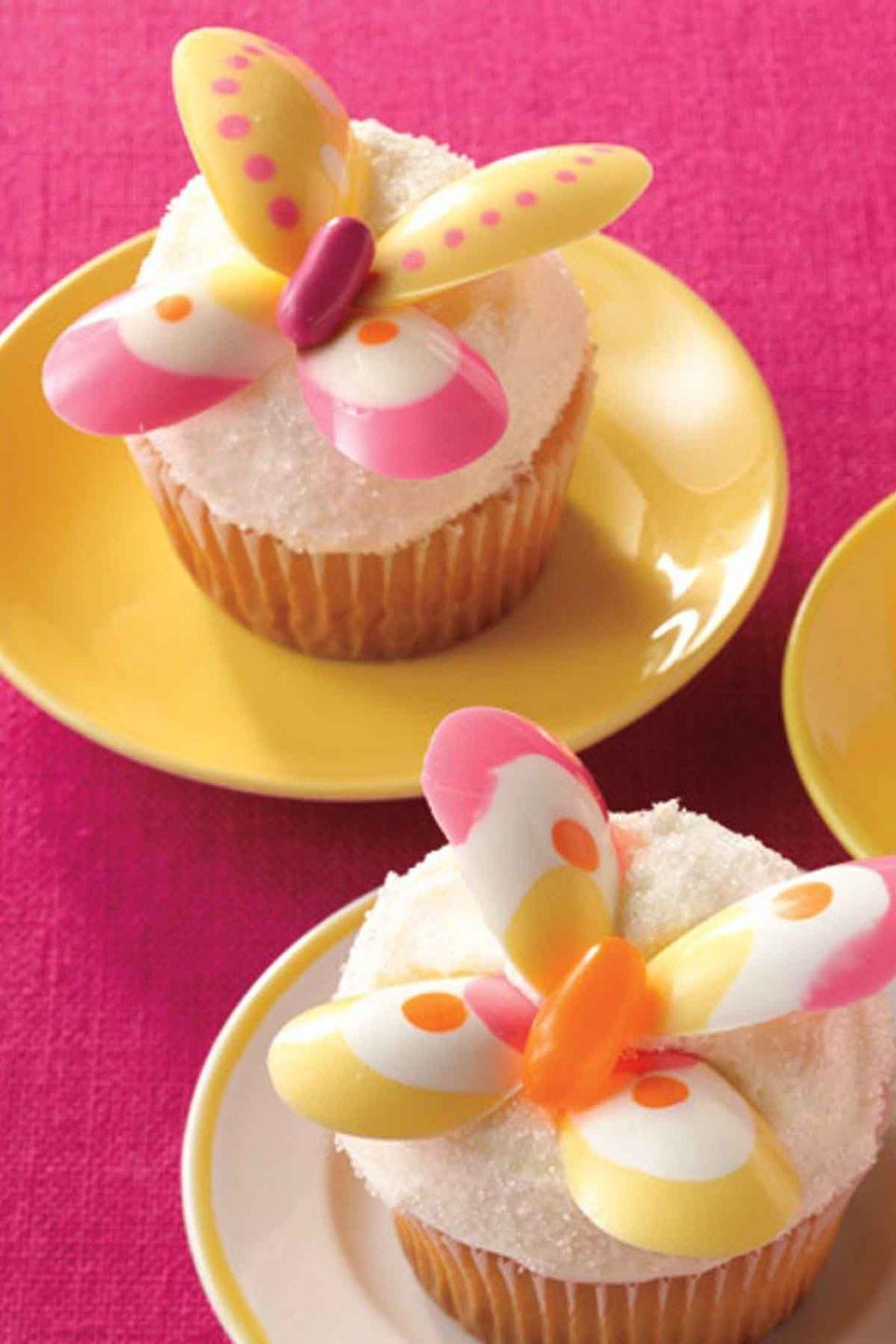 """<p>These bright, spring-inspired butterfly cupcakes will bring a pop of color and flavor to your dessert table. </p><p><strong><em><a href=""""https://www.womansday.com/food-recipes/food-drinks/recipes/a11266/lemon-butterfly-cakes-recipe/"""" rel=""""nofollow noopener"""" target=""""_blank"""" data-ylk=""""slk:Get the Lemon Butterfly Cakes recipe."""" class=""""link rapid-noclick-resp"""">Get the Lemon Butterfly Cakes recipe. </a></em></strong></p>"""
