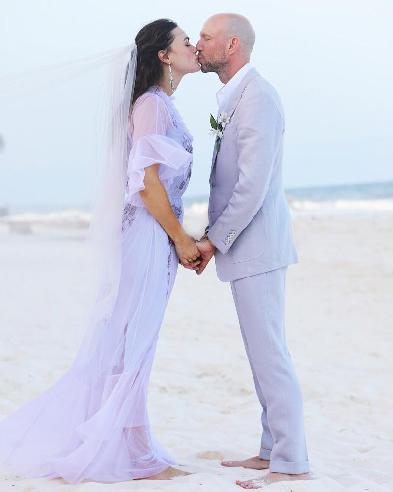 Model and artist Myla Dalbesio painstakingly tracked down a lavender wedding dress just like her late mother's to marry Nathan Hageman at a ceremony on the beach in Tulum.