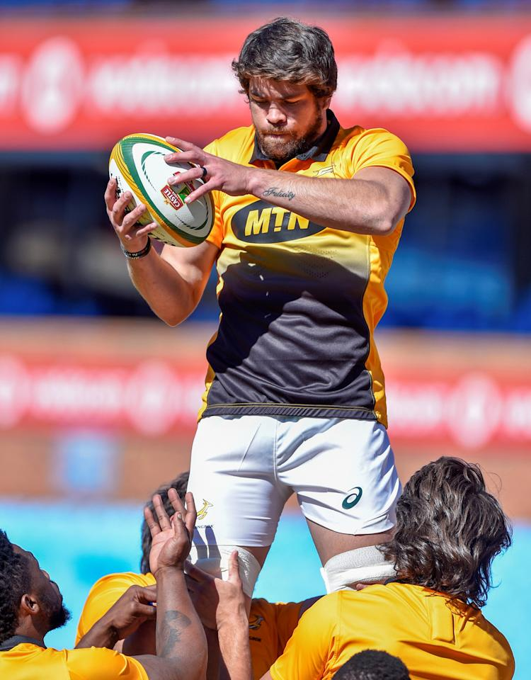 (FILES) This file photo taken on June 9, 2017 shows South Africa's Warren Whiteley catching the ball during a training session at St David's Marist School at Loftus rugby stadium in Pretoria, South Africa, on the eve of a Test rugby union match between France and South Africa. Coach Allister Coetzee, defence specialist Brendan Venter and skipper Warren Whiteley and his Golden Lions have been key factors in the resurgence of South Africa this year. Should they beat France at Ellis Park stadium in Johannesburg on June 24, 2017 the Springboks will complete a 3-0 series whitewash eight months after being jeered by supporters. (AFP Photo/CHRISTIAAN KOTZE)