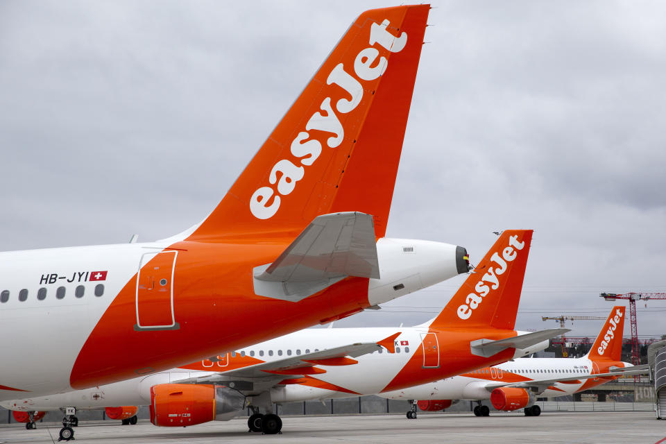 A large number of easyJet aircrafts are parked on the tarmac of the Geneve Aeroport, in Geneva, Switzerland, Monday, March 30, 2020. EasyJet, a British low-cost airline, on 30 March 2020 said it is ground its entire fleet of more than 300 planes amid ongoing Coronavirus COVID-19 crisis. The new coronavirus causes mild or moderate symptoms for most people, but for some, especially older adults and people with existing health problems, it can cause more severe illness or death. (Salvatore Di Nolfi/Keystone via AP)