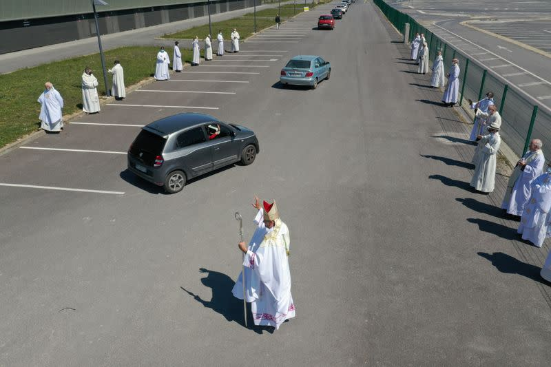 French Catholics celebrate mass in parking lot
