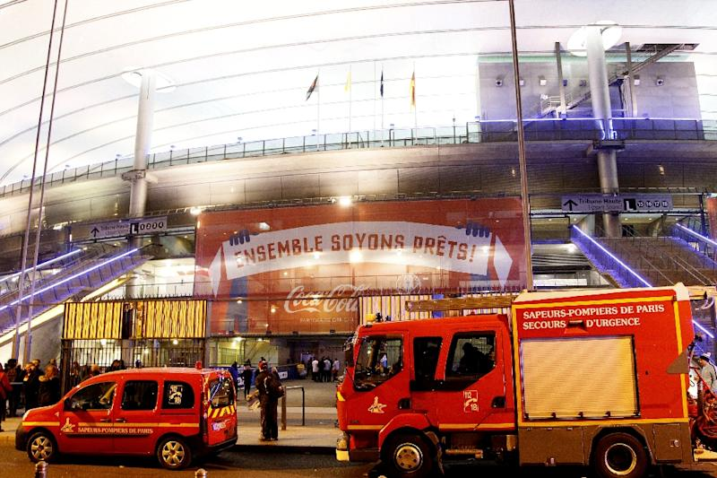 Emergency services vehicles arrive at the Stade de France in Saint Denis, suburban Paris on November 13, 2015 after simultaneous attacks in Paris left at least 39 people dead