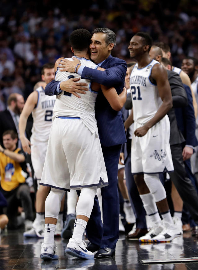 Villanova head coach Jay Wright hugs guard Jalen Brunson (1) at the end of the championship game against Michigan in the Final Four NCAA college basketball tournament, Monday, April 2, 2018, in San Antonio. Villanova won 79-62. (AP Photo/Eric Gay)