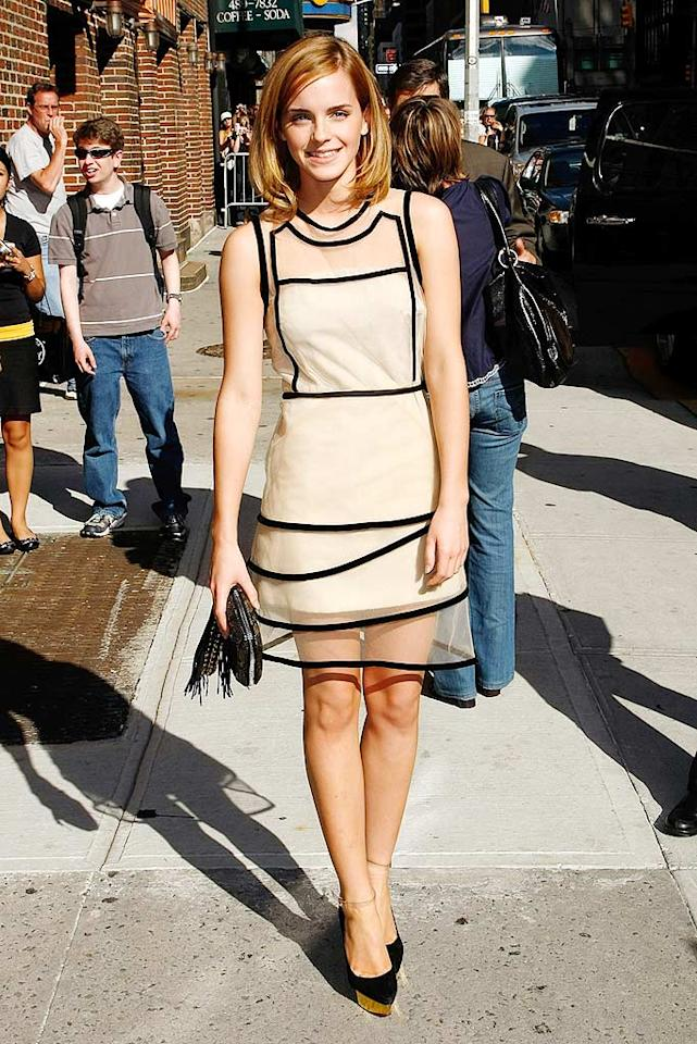 """Harry Potter"" hottie Emma Watson was the epitome of elegance in an organza Christopher Kane tiered dress with black trim as she posed for photographers before entering the Ed Sullivan Theater in Manhattan to promote her new movie. Jeffrey Ufberg/<a href=""http://www.wireimage.com"" target=""new"">WireImage.com</a> - July 8, 2009"