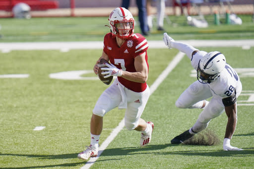 Nebraska quarterback Luke McCaffrey (7) is pursued by Penn State defensive end Jayson Oweh (28) during the first half of an NCAA college football game in Lincoln, Neb., Saturday, Nov. 14, 2020. (AP Photo/Nati Harnik)