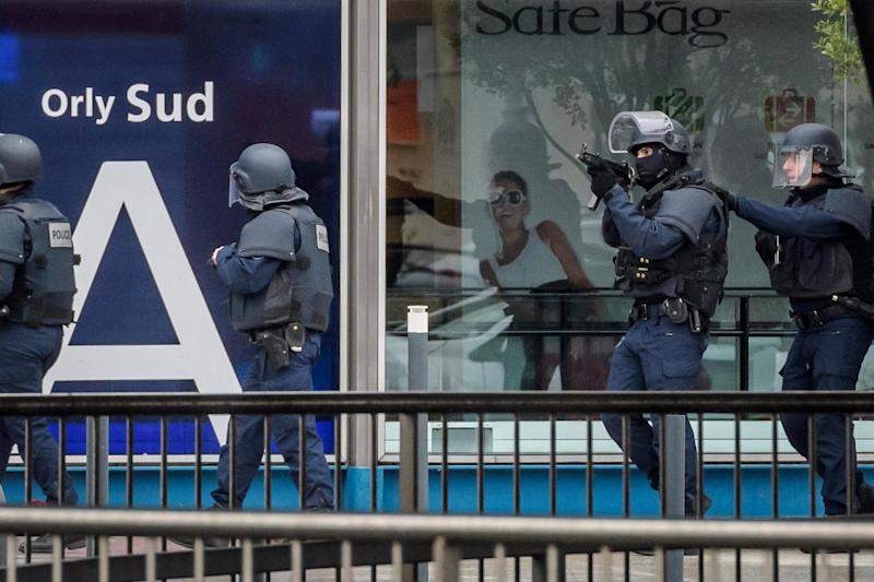 Lockdown: Armed police at the airport: EPA