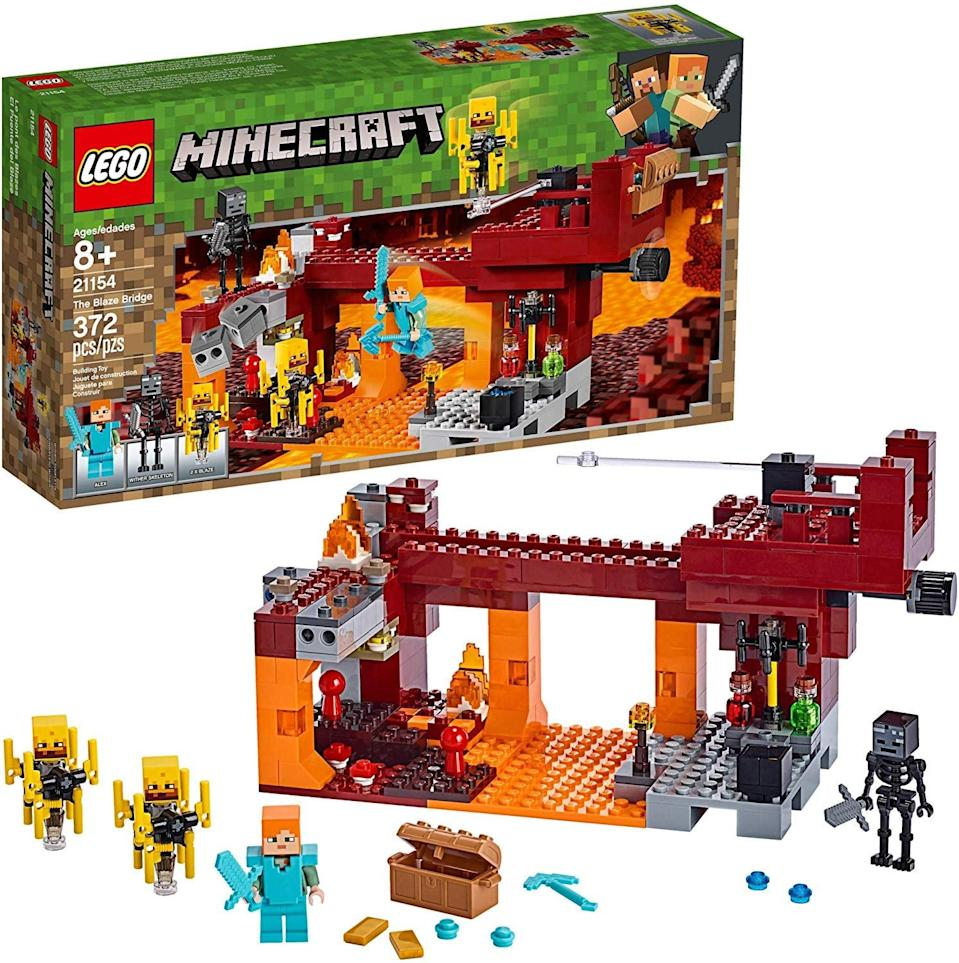 """<p>One of the most popular video games comes to life thanks to this <a href=""""https://www.popsugar.com/buy/Lego-Minecraft-Blaze-Bridge-Building-Kit-492610?p_name=Lego%20Minecraft%20The%20Blaze%20Bridge%20Building%20Kit&retailer=amazon.com&pid=492610&price=45&evar1=moms%3Aus&evar9=32519221&evar98=https%3A%2F%2Fwww.popsugar.com%2Ffamily%2Fphoto-gallery%2F32519221%2Fimage%2F36166876%2FLego-Minecraft-Blaze-Bridge-Building-Kit&list1=gifts%2Choliday%2Cgift%20guide%2Cgifts%20for%20kids%2Ckid%20shopping%2Ctweens%20and%20teens%2Choliday%20for%20kids%2Cgifts%20for%20teens&prop13=api&pdata=1"""" class=""""link rapid-noclick-resp"""" rel=""""nofollow noopener"""" target=""""_blank"""" data-ylk=""""slk:Lego Minecraft The Blaze Bridge Building Kit"""">Lego Minecraft The Blaze Bridge Building Kit</a> ($45).</p>"""