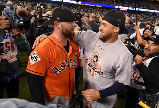 <p>Brian MCCann #16 and George Springer #4 of the Houston Astros celebrate after the final out of Game 7 of the 2017 World Series against the Los Angeles Dodgers at Dodger Stadium on Wednesday, November 1, 2017 in Los Angeles, California. The Astros defeated the Dodgers 5-1. (Photo by LG Patterson/MLB Photos via Getty Images) </p>