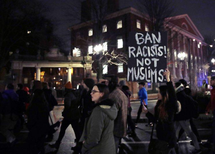 Several hundred people march past the gates of Harvard Yard at Harvard University while protesting the travel ban in Cambridge, Mass., on March 7, 2017. (Photo: Charles Krupa/AP)