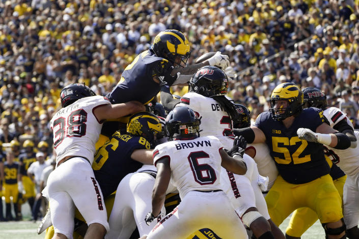 Michigan running back Blake Corum (2) dives for a one-yard touchdown run against Northern Illinois in the second half of a NCAA college football game in Ann Arbor, Mich., Saturday, Sept. 18, 2021. (AP Photo/Paul Sancya)