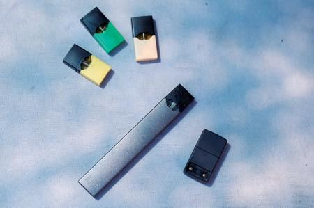 A Juul e-cigarette and pods are seen in this picture illustration