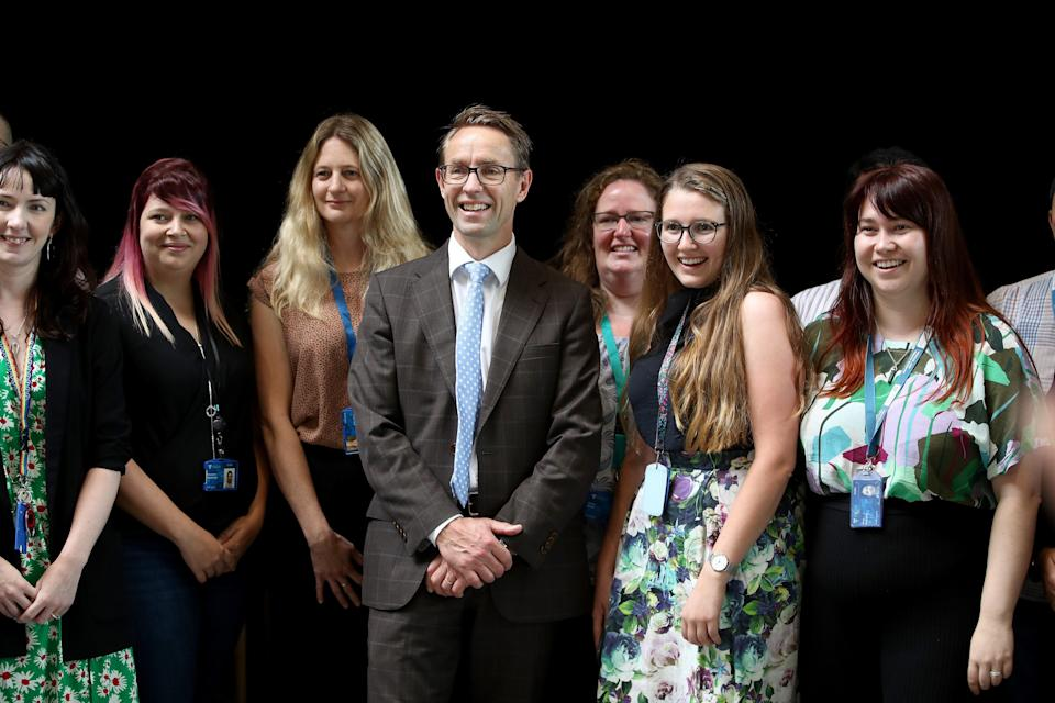 Director General of Health Ashley Bloomfield poses with people during a visit to Auckland UniversityGetty Images
