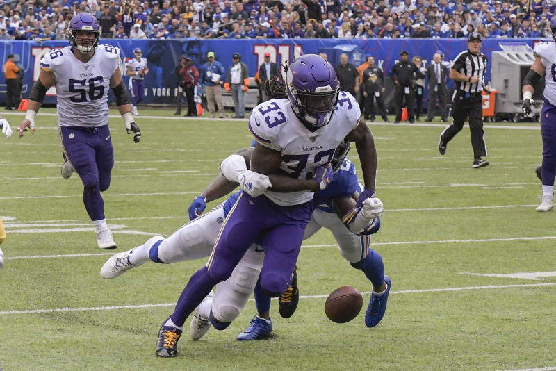 Minnesota Vikings running back Dalvin Cook is stripped of the ball for a fumble by New York Giants free safety Jabrill Peppers (21) during the second quarter of an NFL football game, Sunday, Oct. 6, 2019, in East Rutherford, N.J. (AP Photo/Bill Kostroun)