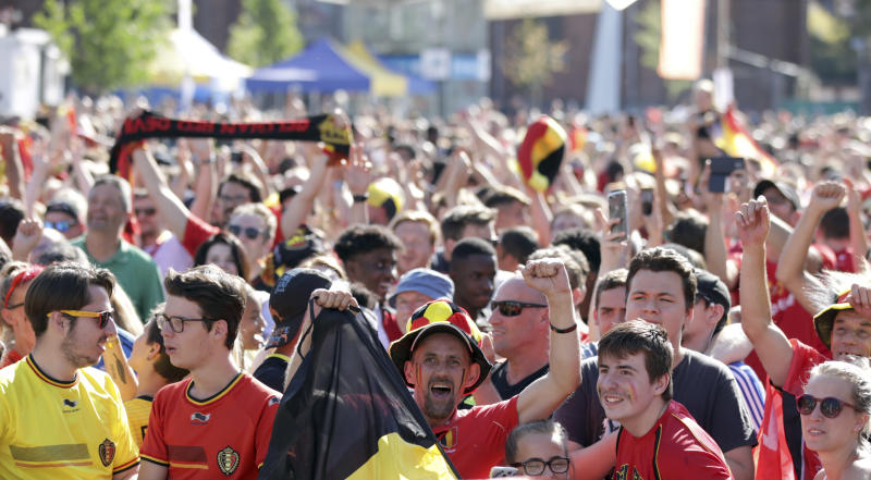 Belgium soccer fan reacts as they watch a 2018 World Cup soccer match between Belgium and England on a giant screen in Jette, Belgium, Saturday, July 14, 2018. The match will determine third place. (AP Photo/Olivier Matthys)
