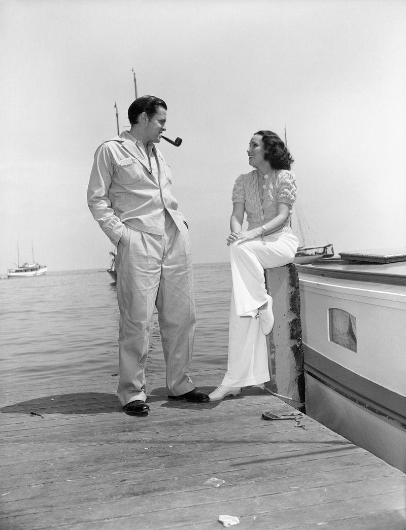 <p>Actress Dolores Del Río looks casually chic in a sweater and white slacks as she and Hollywood director, Orson Welles, wait at the docks of Santa Catalina in 1940 for the arrival of their fishing boat. </p>