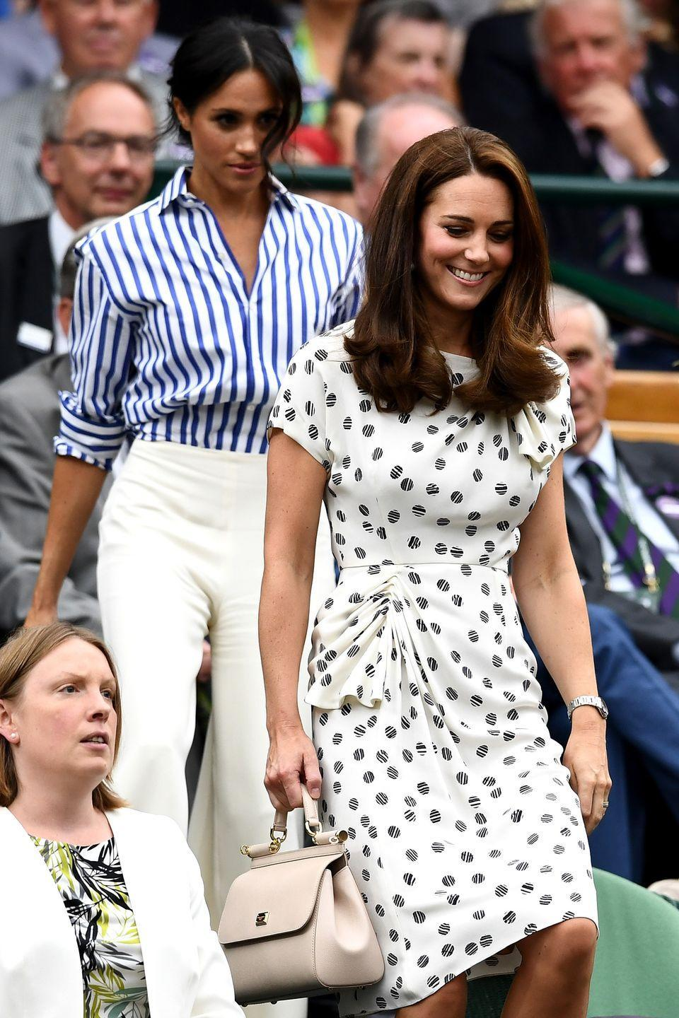 <p><strong>2018</strong> Meghan wore a striped Ralph Lauren shirt with white wide-leg trousers, while Kate opted for a printed Jenny Packham dress.</p>