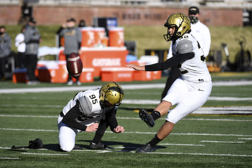 Vanderbilt place kicker Sarah Fuller warms up before the start of an NCAA college football game against Missouri Saturday, Nov. 28, 2020, in Columbia, Mo. (AP Photo/L.G. Patterson)