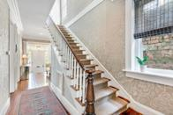 <p>The home's main staircase has been restored to its original glory.</p>