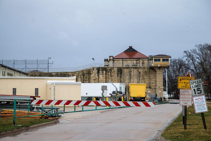 A barricade is closed at a road near the Anamosa State Penitentiary, Tuesday, March 23, 2021, in Anamosa, Iowa.
