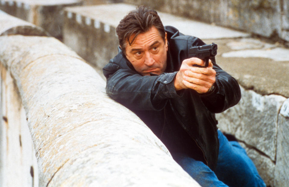 Robert De Niro aiming gun in a scene from the film 'Ronin', 1998. (Photo by United Artists/Getty Images)