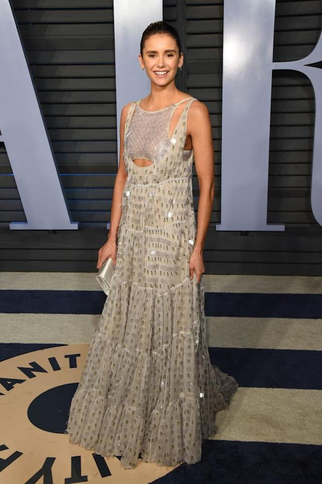 <p>Nina Dobrev attends the 2018 Vanity Fair Oscar Party on March 4, 2018, in Beverly Hills. (Photo: J. Merritt/Getty Images) </p>