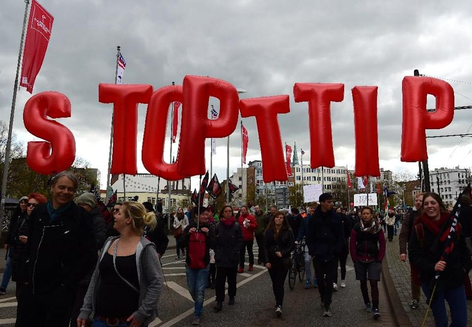 Tens of thousands of protesters marched through the German city of Hannover to show their opposition to the TTIP trade deal on April 23, 2016 (AFP Photo/John MacDougall)