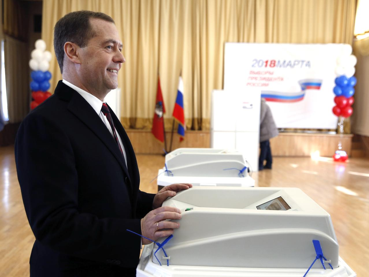 Russian Prime Minister Dmitry Medvedev votes in the Russian presidential election in Moscow, Russia, Sunday, March 18, 2018. Vladimir Putin headed to an overwhelming win in Russia's presidential election Sunday, adding six years in the Kremlin for the man who has led the world's largest country for all of the 21st century. (Dmitry Astakhov, Sputnik, Government Pool Photo via AP)