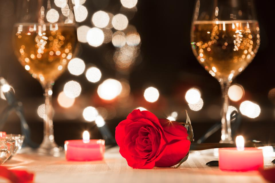 Romantic candlelight dinner in luxury restaurant.