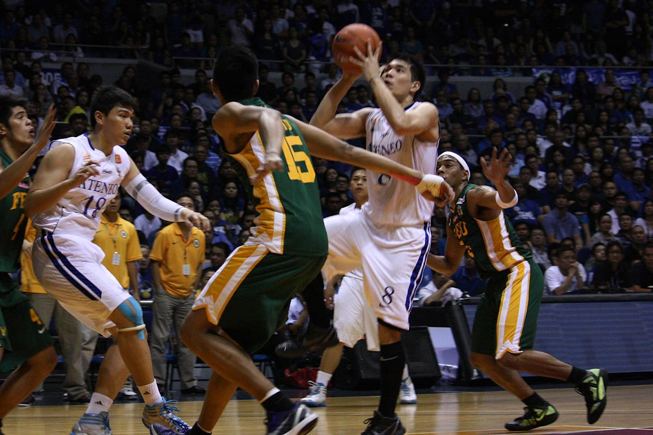 Nico Salva of Ateneo Blue Eagles goes for the basket during the UAAP Season 74 second game of the best-of-three championship series against FEU Tamaraws held at Smart Araneta Coliseum in Quezon City. (Marlo Cueto/NPPA Images)