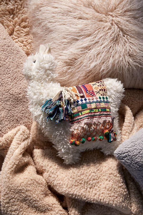 """Your friend's bed is probably filled with a museum-worthy collection of pillows. So another one won't hurt, especially if it's this cute. <strong><a href=""""https://fave.co/2LuObk2"""" rel=""""nofollow noopener"""" target=""""_blank"""" data-ylk=""""slk:Get it now for $49 at Urban Outfitters"""" class=""""link rapid-noclick-resp"""">Get it now for $49 at Urban Outfitters</a></strong>."""