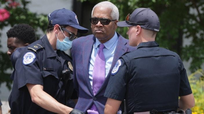 """Georgia Rep. Hank Johnson (center) is arrested by U.S. Capitol Police during a """"Brothers Day of Action on Capitol Hill"""" protest event outside Hart Senate Office Building Thursday in Washington, D.C. (Photo by Alex Wong/Getty Images)"""
